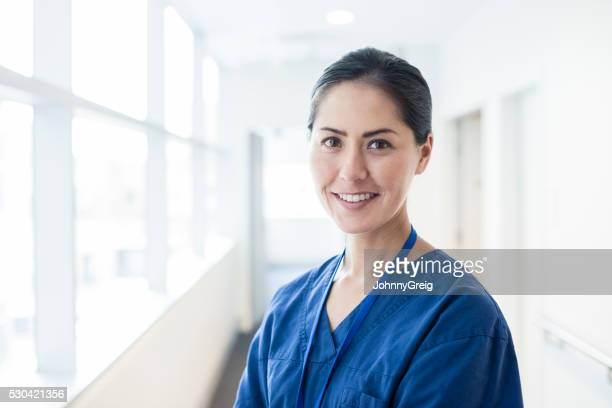 Female Asian nurse smiling towards camera, portrait