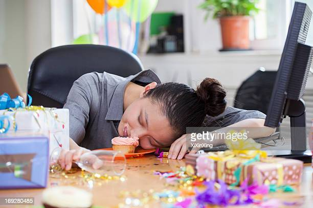 female asleep after party at office - hangover stock pictures, royalty-free photos & images