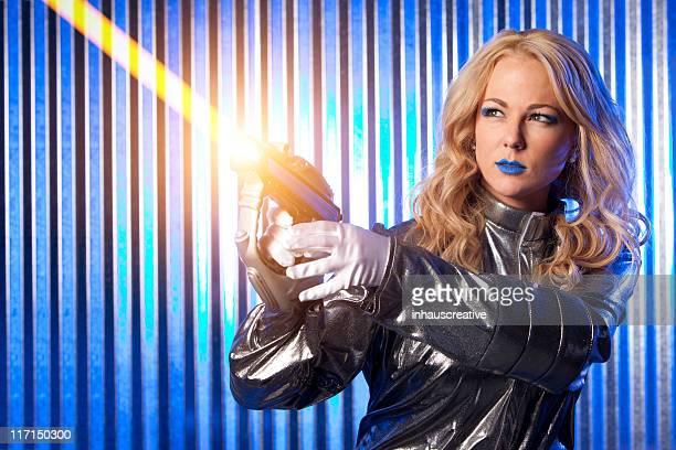 女性宇宙飛行士スペースの戦士 - 銃 ストックフォトと画像