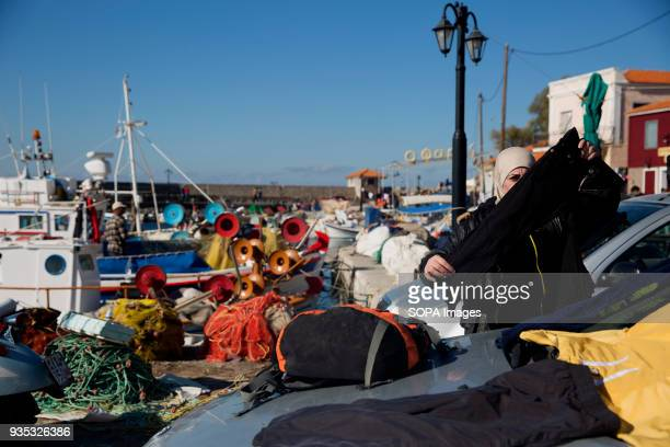 A female asylumseeker looks through clothing provided by NGOs and left by the port In 2015 more than a million immigrants arrived in Europe by sea...