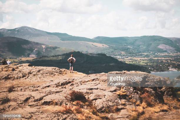 female at the top of a fell looking out over veiw - keswick stock photos and pictures