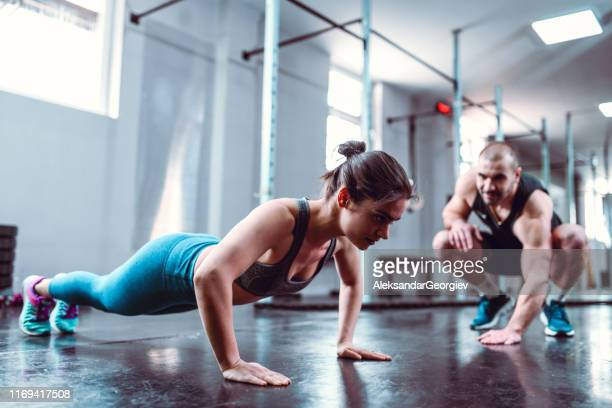 female athlete and her male instructor - fitness instructor stock pictures, royalty-free photos & images