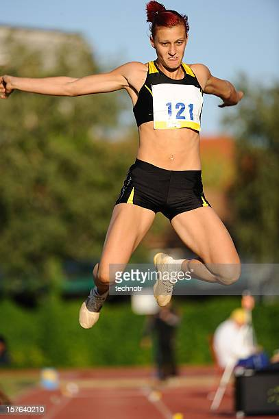 female athlete at long jump - women's field event stock pictures, royalty-free photos & images