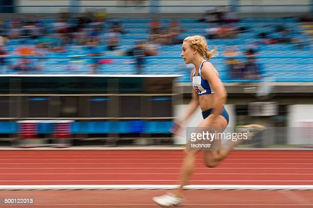 Female Athlete at Run Before a Jump