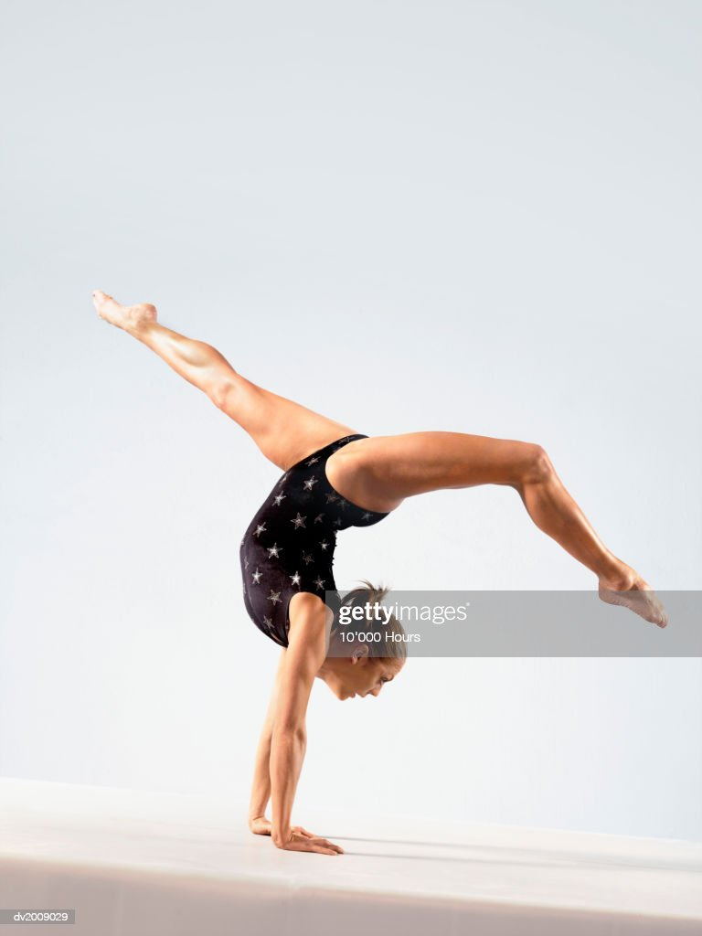 Female Athlete Balancing on Her Hands : Stock Photo