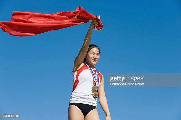 female athlete being honored on podium - gold medal stock pictures, royalty-free photos & images