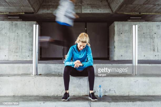 female athlete checking pulse trace - fitness tracker stock pictures, royalty-free photos & images