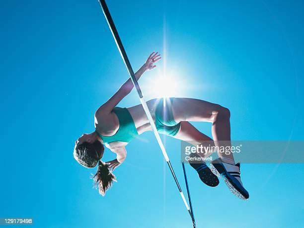 Female athlete clearing high jump