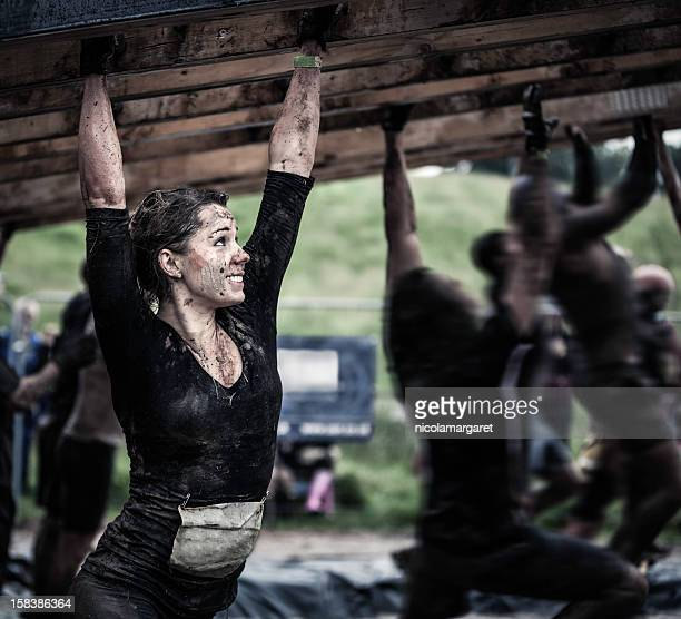 female athlete competing in an obstacle course - obstacle course stock photos and pictures