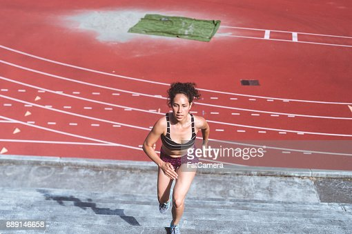 Female Athlete Cross Training at Stadium