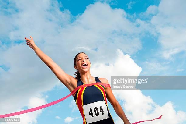 Female athlete crossing the finish line
