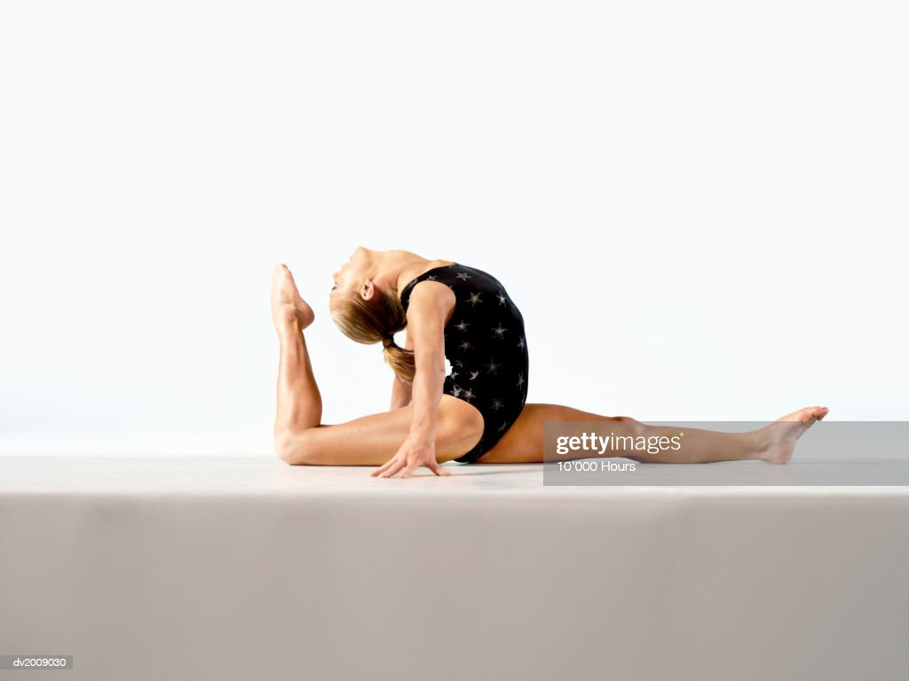 Female Athlete Doing the Split : Stock Photo