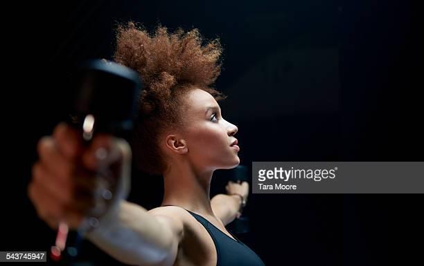 Female athlete exercising with dumbbells