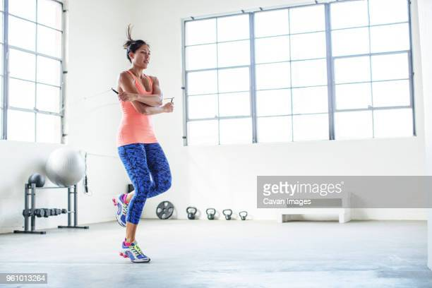female athlete exercising with jumping rope in gym - skipping rope stock pictures, royalty-free photos & images