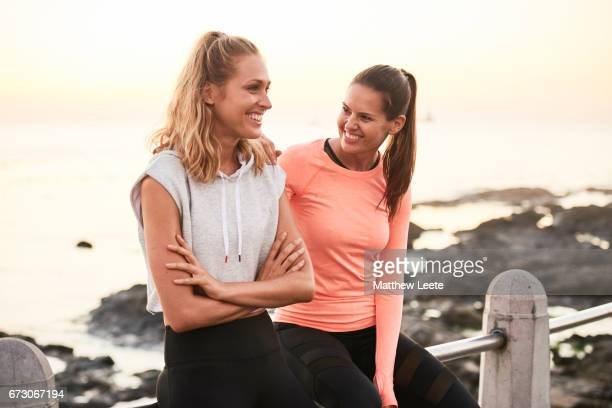female athlete friends laughing - matthew hale stock pictures, royalty-free photos & images