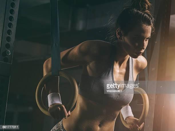 female athlete, gymnastic rings - attività foto e immagini stock