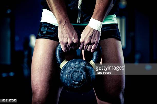 female athlete holding kettlebell - robb reece stock pictures, royalty-free photos & images