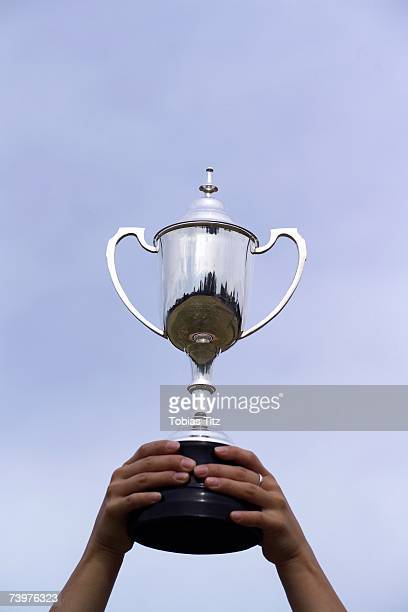 Female athlete holding up a trophy
