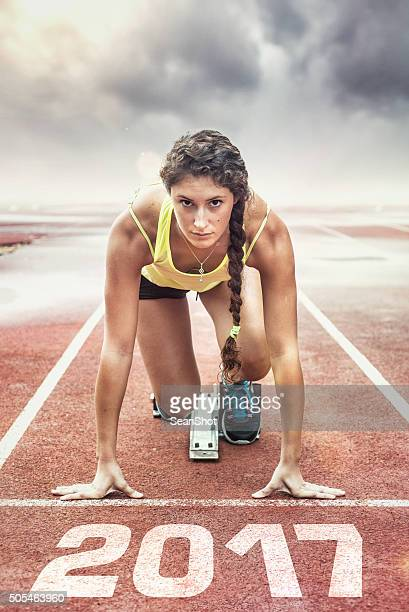 female athlete in the starting blocks - forward athlete stock pictures, royalty-free photos & images