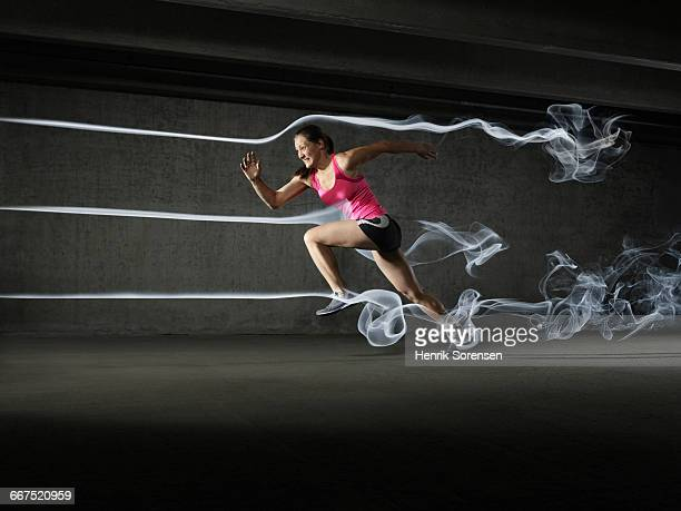 female athlete in windtunnel - aerodynamic stock pictures, royalty-free photos & images