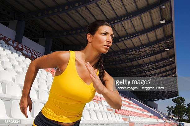 Female athlete jogging at stadium