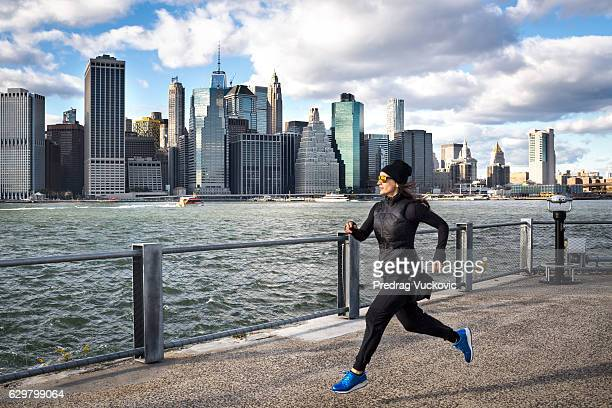 Female athlete jogging on the pier