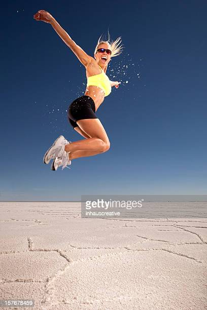 Female Athlete Jumping Down