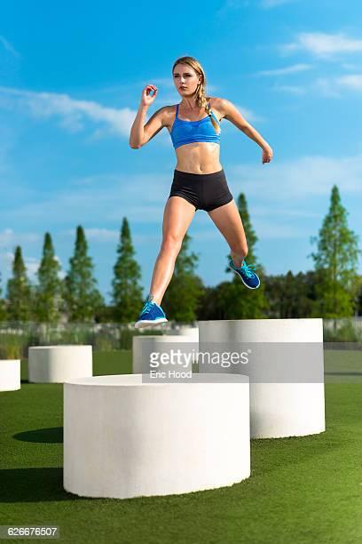 Female athlete leaping