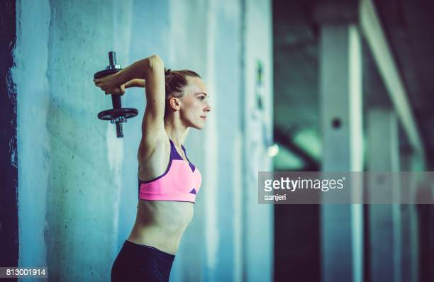Female Athlete Lifting Weights