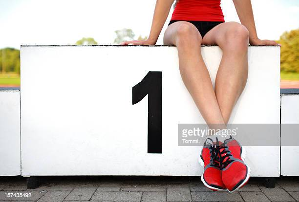 female athlete on winners podium - winners podium stock pictures, royalty-free photos & images