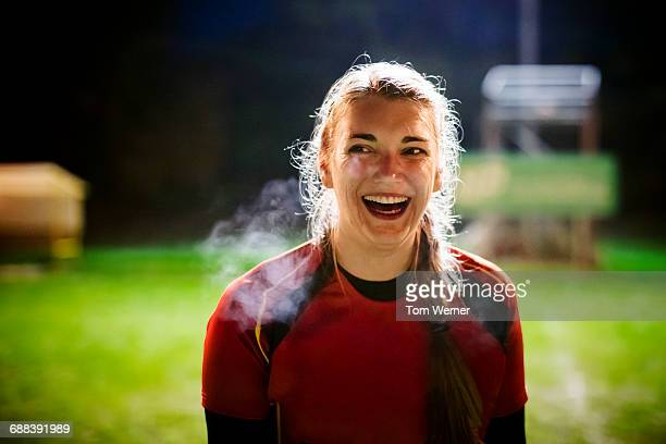 female athlete portrait at night - rugby sport stock pictures, royalty-free photos & images