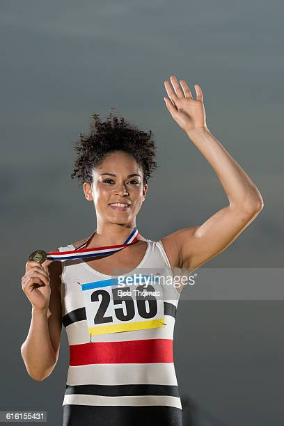Female Athlete Poses With Her Winners Medal
