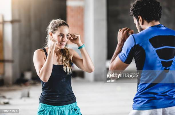 Female Athlete Practicing With Trainer