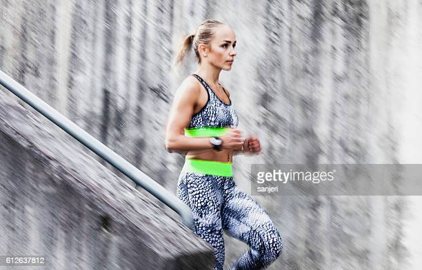 Female Athlete Running Down the Staircase