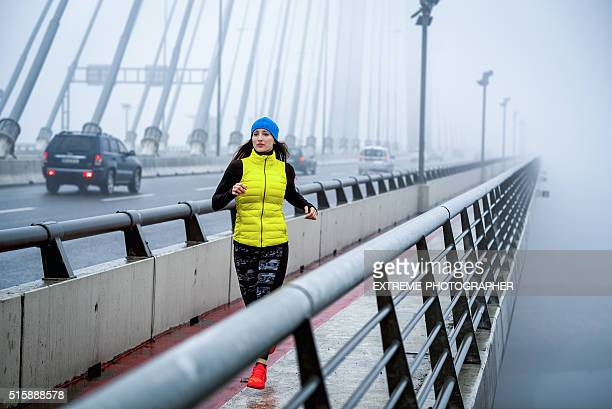 Female athlete running in the winter morning