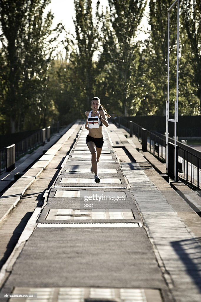 Female athlete running : Foto stock