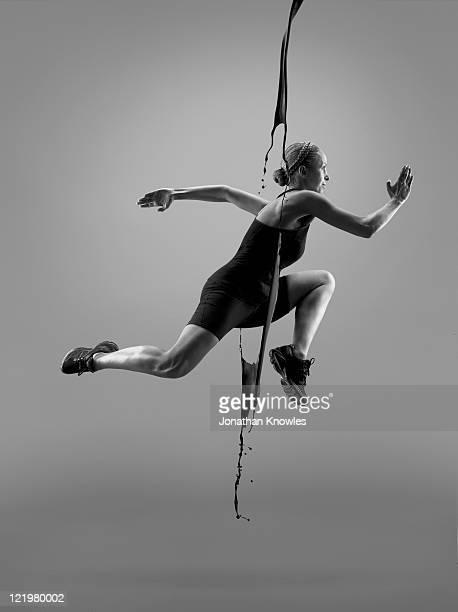 Female athlete running through liquid