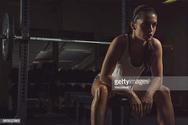 female athlete sitting on bench, contemplating - 女性選手 ストックフォトと画像