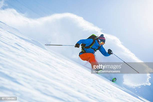 Female athlete skiing in deep powder.