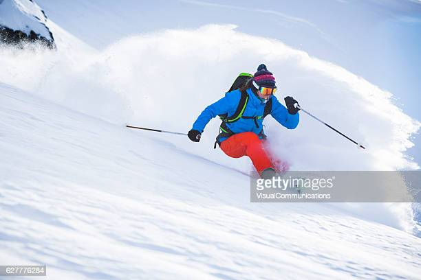 female athlete skiing in deep powder. - female skier stock pictures, royalty-free photos & images