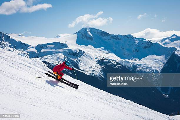 Female athlete skiing in the mountains