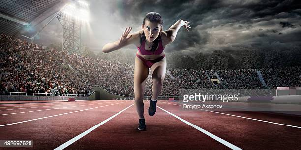 female athlete sprinting - all weather running track stock pictures, royalty-free photos & images