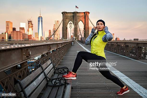 Female athlete stretching on the bridge