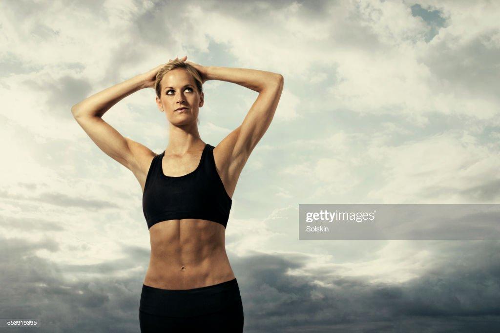 Female athlete stretching : Stock Photo