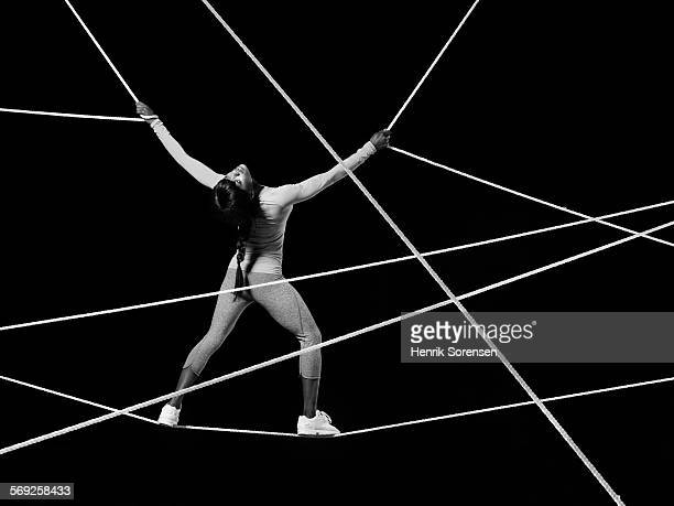Female athlete suspended in ropes