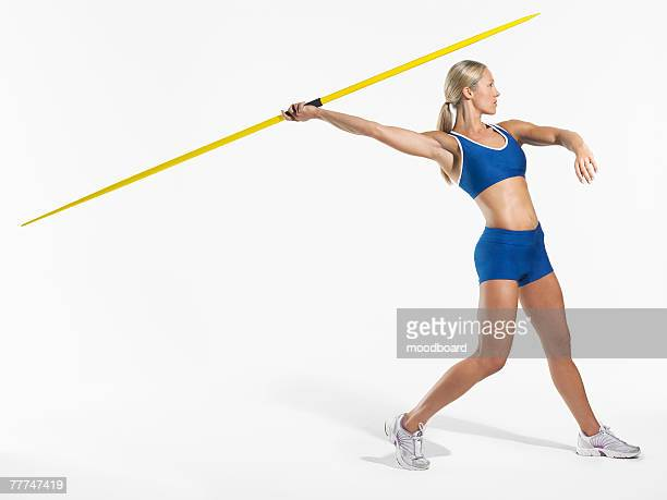 female athlete throwing javelin - javelin stock pictures, royalty-free photos & images