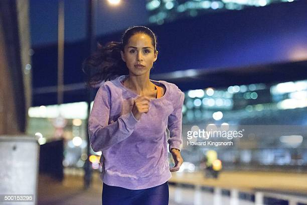 female athlete, urban setting at night - image focus technique stock pictures, royalty-free photos & images