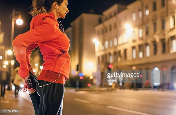 Female Athlete Warming up for a Late Night Jogging