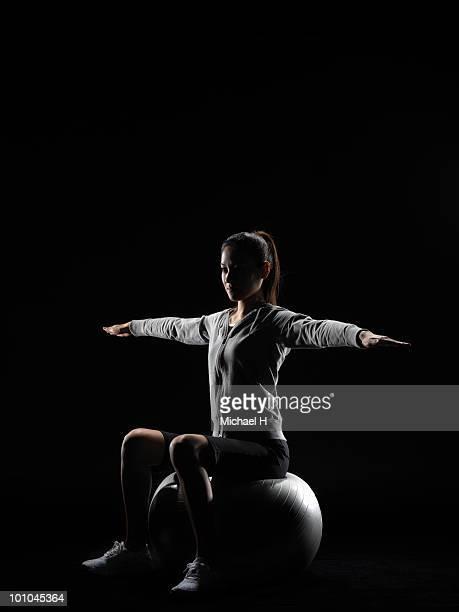 Female athlete who does balance ball