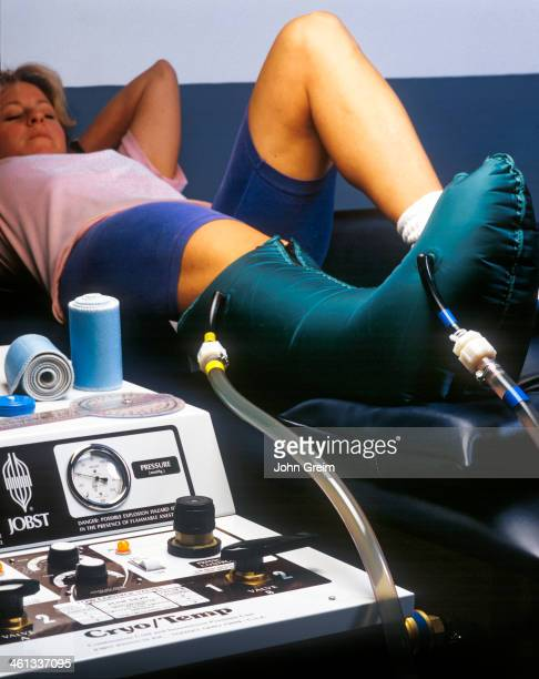 Female athlete with ankle injury in a Jobst cryo temp machine which applies both heat or cold and pressue to help heal sports injuries